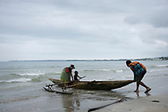 Three generations -- a mother, son, and grandmother -- push off from the beach in their outrigger canoe in Wewak, Papua New Guinea (July 2017)