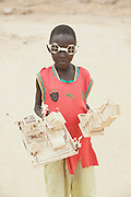 A loacl boy sells models made from wooden reeds in the village of Djinglya, in the north of Cameroon
