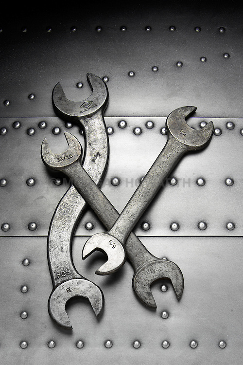 Three wrenches on riveted steel background VA2_064_958
