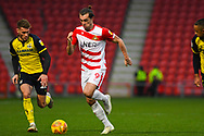 John Marquis of Doncaster Rovers (9) gets past Andy Dales of Scunthorpe United (12) during the EFL Sky Bet League 1 match between Doncaster Rovers and Scunthorpe United at the Keepmoat Stadium, Doncaster, England on 15 December 2018.