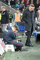 Football - 2017 / 2018 Premier League - Swansea City vs. Southampton<br /> <br /> Swansea City manager Carlos Carvalhal looks down & a ball boy holds his head, looks sad, after southampton score, at Liberty Stadium.<br /> <br /> COLORSPORT/WINSTON BYNORTH