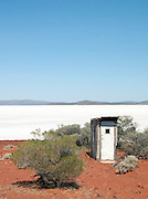 Outhouse dunny at Lake Gairdner, dried up to create a salt flat, Gawler Ranges, South Australia, Australia