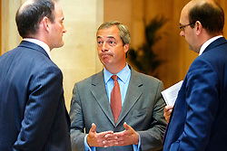 "© Licensed to London News Pictures. 17/06/2015. London, UK. UKIP leader NIGEL FARAGE talking to UKIP MP DOUGLAS CARSWELL and MARK RECKLESS before launching ""The Truth About Trade Beyond The EU"" pamphlet in central London, on Wednesday, June 17, 2015. Photo credit: Tolga Akmen/LNP"