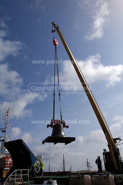 UK, Penzance - Monday, March 23, 2009: A bell is lifted by a crane on to the Isles of Scilly Steamship Company's supply vessel the Gry Maritha to be transported to St Mary's. (Image by Peter Horrell / http://www.peterhorrell.com)