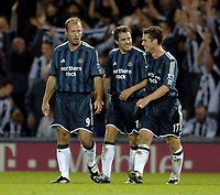Photo: Glyn Thomas.<br />West Bromwich Albion. Newcastle Utd. The Barclays Premiership. 30/10/2005.<br /> Newcastle's Michael Owen (C) celebrates his second goal with Alan Shearer (L) and Scott Parker.