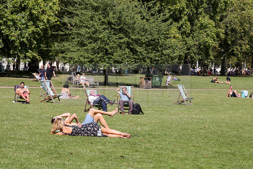 © Licensed to London News Pictures. 24/08/2019. London, UK. People enjoy the weather in London's St James's Park as the hot weather continues. According to the Met Office, the temperatures are forecast to reach between 31 and 33 degrees celsius in the south-east of England. Photo credit: Dinendra Haria/LNP