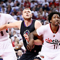 25 April 2016: Los Angeles Clippers center Cole Aldrich (45) vies for the rebound with Portland Trail Blazers center Ed Davis (17) and Portland Trail Blazers guard Gerald Henderson (9) during the Portland Trail Blazers 98-84 victory over the Los Angeles Clippers, during Game Four of the Western Conference Quarterfinals of the NBA Playoffs at the Moda Center, Portland, Oregon, USA.
