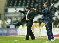 Photo: Aidan Ellis.<br /> Derby County v Leicester City. Coca Cola Championship. 01/10/2005.<br /> Derby manager Phil Brown (background) and Leicester manager give instructions out to their teams