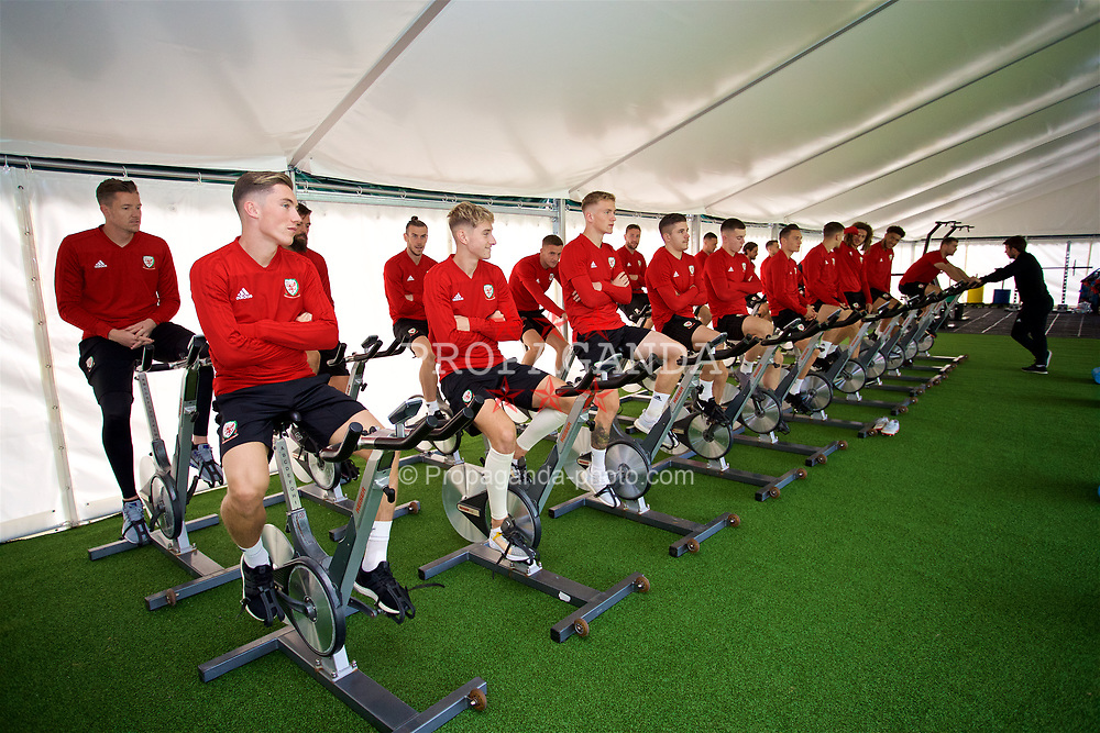 CARDIFF, WALES - Friday, September 7, 2018: Wales players on warm-up bikes during a training session at the Vale Resort ahead of the UEFA Nations League Group Stage League B Group 4 match between Denmark and Wales. Harry Wilson, David Brooks, Matthew Smith, Declan John. (Pic by David Rawcliffe/Propaganda)