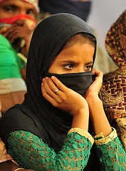 October 28, 2016 - Allahabad, Uttar Pradesh, India - Allahabad: A Shia Muslim devotee watch the mourning procession during Muharram in Allahabad on 28-10-2016, Muharram is celebrated to mark the climax of the mourning which is Called Ashura, The ccommenmoration of Imam Hussain's. photo by prabhat kumar verma (Credit Image: © Prabhat Kumar Verma via ZUMA Wire)