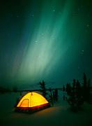 Winter camping at Tahneta Pass with northern lights dancing overhead, April 17-18, 2001, Alaska.
