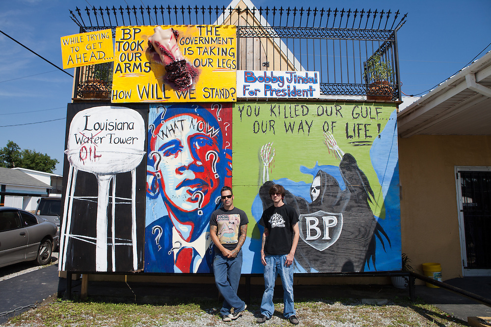 Bobby Pirtre and his assistant on US Highway 1 in front of a mural they made on a tattoo shop, his response to the BP oil spill.