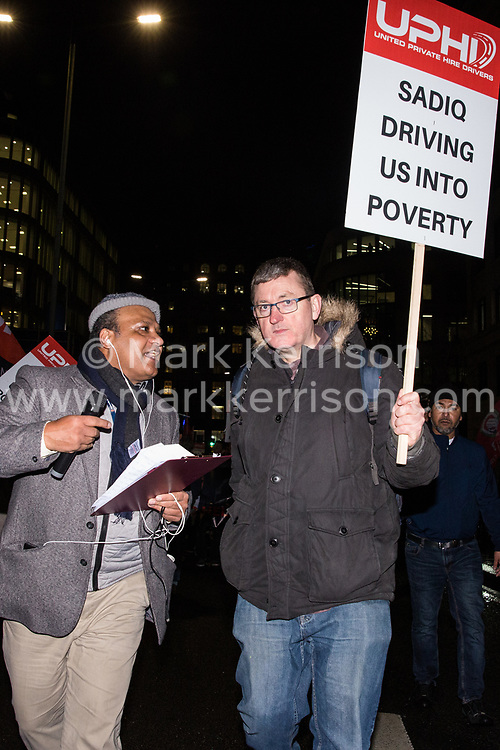 London, UK. 4th February, 2019. James Farrar joins hundreds of Uber minicab drivers blocking London Bridge as part of a protest organised by the United Private Hire Drivers (UPHD) branch of the Independent Workers Union of Great Britain's (IWGB)  following the introduction in December of congestion charges for minicabs.