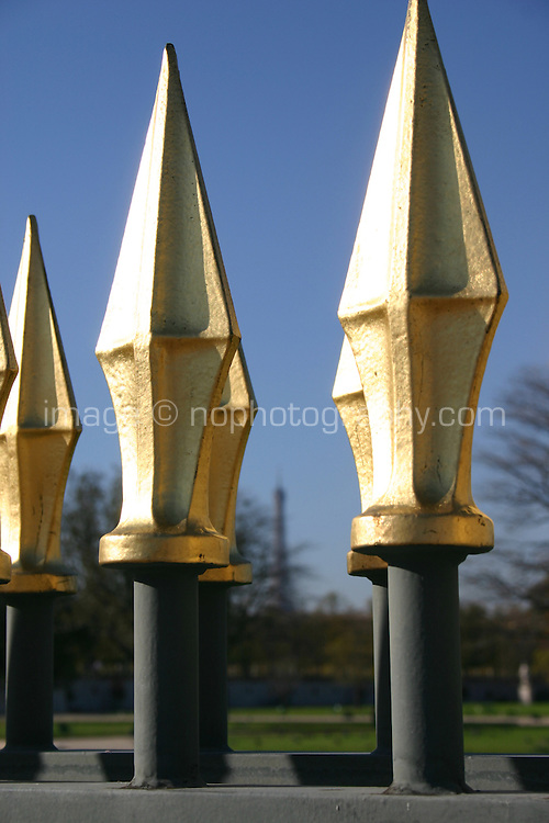 Gold topped railings in Tuileries gardens Paris France<br />