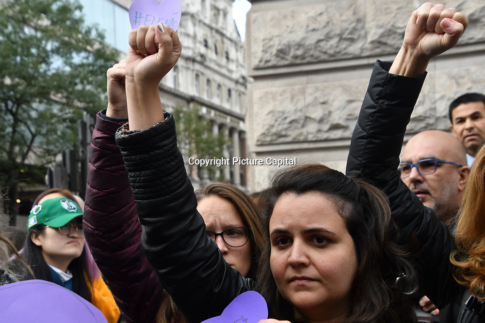 Brazilian women agaimst fascism counter far-rights outside Brazil embassy will the Brazilian people queuing to vote for the Brazil election in London, UK. 7 October 2018.