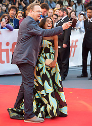 """Actors Rachel Hilson and Peter Mackenzie take a selfie as they arrive on the red carpet for the movie """"Kings"""" during the 2017 Toronto International Film Festival in Toronto, ON, Canada, on Wednesday, September 13, 2017. Photo by Frank Gunn/CP/ABACAPRESS.COM"""