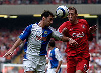Photo: Glyn Thomas.<br />Liverpool v Blackburn Rovers. The Barclays Premiership.<br />15/10/2005.<br />Liverpool's Peter Crouch (R) battles for the ball with Zurab Khizanishvili.