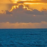 A sunset glows over the Pacific Ocean near Half Moon Bay, California.
