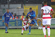 AFC Wimbledon defender Paul Kalambayi (30) battles for possession during the The FA Cup match between AFC Wimbledon and Doncaster Rovers at the Cherry Red Records Stadium, Kingston, England on 9 November 2019.