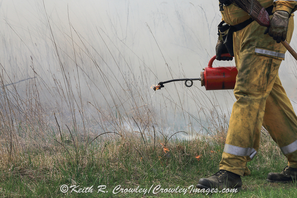 Wisconsin Department of Natural Resources field technicians conduct a controlled burn on the Three Lakes Wildlife Area near New Richmond, Wisconsin.