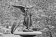 Central Park, New York City, New York, Bethesda Fountain, sculpture  Angel of Waters designed by Emma Stebbins, winter, snow