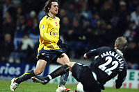 Photo: Paul Greenwood.<br />Bolton Wanderers v Arsenal. The FA Cup. 14/02/2007. Bolton's keeper  Jussi Jaasklainen, right, saves at the feet of Arsenal's Tomas Rosicky