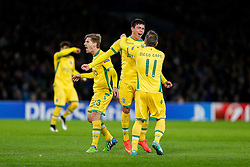 Jonathan Silva of Sporting (centre) celebrates with Adrien Silva and Diego Capel after scoring a goal to make it 2-1 - Photo mandatory by-line: Rogan Thomson/JMP - 07966 386802 - 10/12/2014 - SPORT - FOOTBALL - London, England - Stamford Bridge - Sporting Clube de Portugal - UEFA Champions League Group G.