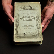 Luise Poulton, Rare Books Manager Special Collections  holds an original copy of Charles Dicken's The Posthumous Papers of the Pickwick Club in the rare book collection at the J. Willard Marriott Library on the campus of the University of Utah in Salt Lake City, Utah Wednesday Oct. 10, 2012. (Photo by August Miller).