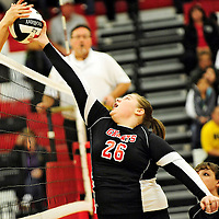 110612  Adron Gardner<br /> <br /> Grants Pirate Kami Bratzel (26) tips simultaneously as a Belen Eagle in the 4A volleyball district tournament in Grants Tuesday.