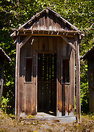 Tiny rustic cabins in a line are a tourist attraction in Ashford, WA, USA
