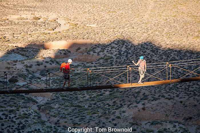 Climbing the Via Ferratta routes on the property of the Amangiri resort, Utah