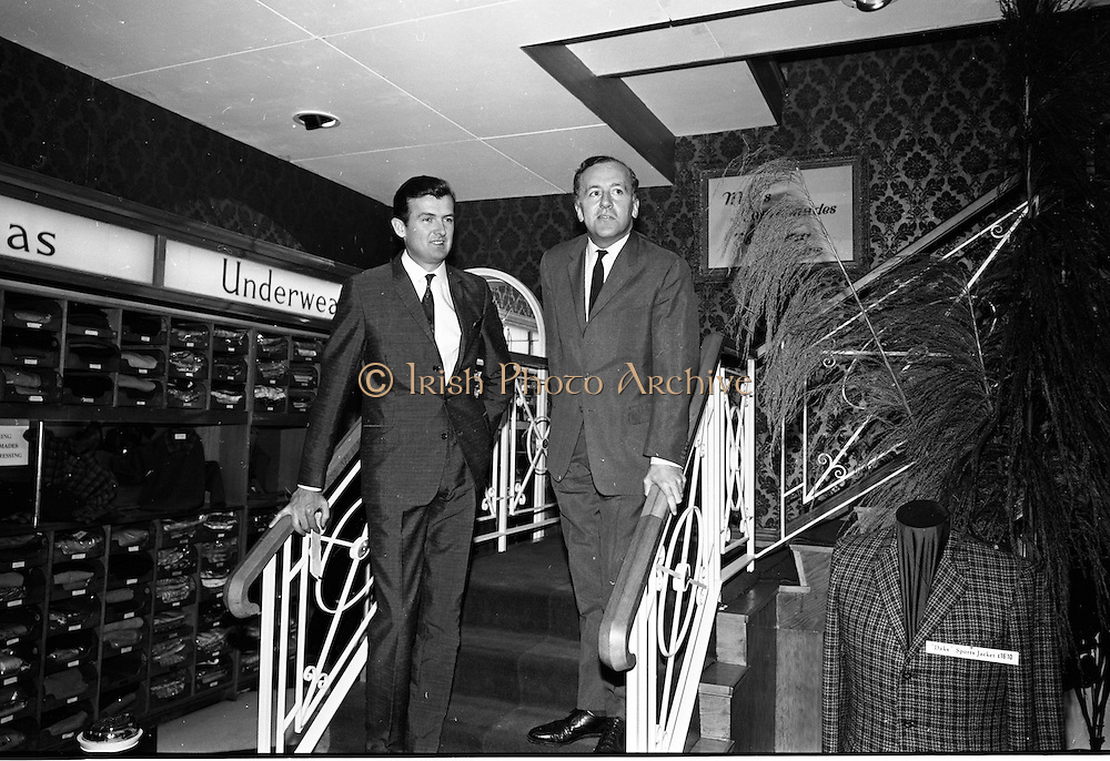 17/07/1967<br /> 07/17/1967<br /> 17 July 1967<br /> Opening of new men's salon at Brown Thomas, Grafton Street, Dublin. Brendan O'Reilly, the TV personality opened a new Mens Department in Brown Thomas and Co. Ltd.. In the new department was a hairdressing salon where while getting your hair done it was possible to make phone calls from the chair. Image shows John McGuire (right), Managing Director, Brown Thomas Group, introducing Brendan O'Reilly to the people at the opening.