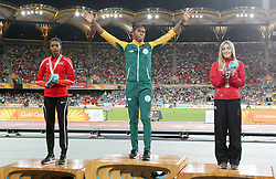 Gold medallist in the Women's 1500m Final South Africa's Caster Semenya (centre) alongside silver medallist Kenya's Beatrice Chepkoech (left) and Wales' Melissa Courtney at the Carrara Stadium during day seven of the 2018 Commonwealth Games in the Gold Coast, Australia.