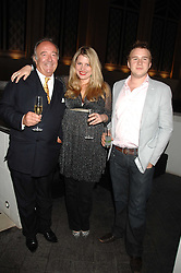 Left to right, SIR DAVID LLEWELLYN, DAISY BUNN and CHARLIE BUNN at the opening of the new Gaucho restaurant at the O2 Arena, London on 15th May 2008.<br />