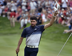 June 24, 2018 - Cromwell, CT, USA - Bubba Watson acknowledges the crowd after birdieing the 18th hole during the final round of the Travelers Championship at TPC River Highlands in Cromwell, Conn., on Sunday, June 24, 2018. (Credit Image: © Brad Horrigan/TNS via ZUMA Wire)
