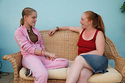 Girl and carer sharing a joke.