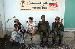 KANDAHAR,AFGHANISTAN - SEPT.6 : Afghan soldiers guard the Governor's house as he meets with tribal elders after he was wounded yesterday during an assassination attempt on President Hamid Karzai, September 6, 2002 in Kandahar, Afghanistan. Governor Gul Agha Sherzai was shot and wounded, not long after 15 people were killed and many others were wounded in blasts in Kabul.. .(Photo by Ami Vitale/Getty Images)