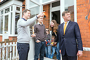 © Licensed to London News Pictures. 26/04/2015. Sutton, UK Deputy NCIK CLEGG AND PAUL BURSTOW meet local residents.  Prime Minister and Leader of the Liberal Democrats Nick Clegg makes a speech today, 26th April 215 in Sutton, to local Liberal Democrats in support of the candidate for Sutton and Cheam, Paul Burstow. Nick Clegg and Paul Burstow also joined local campaigners to deliver leaflets on a nearby street, and put up a Liberal Democrat stakeboard.. Photo credit : Stephen Simpson/LNP