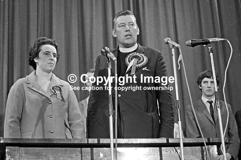 Rev Ian Paisley speaking at the Ballymena count after winning the North Antrim seat in the June 1970 UK General Election. He comfortably beat the incumbent Ulster Unionist, Henry Maitland Clark. He is accompanied by his wife, Eileen Paisley. 197006190230.<br /> <br /> Copyright Image from Victor Patterson, Belfast, UK<br /> <br /> t: +44 28 9066 1296 (from Rep of Ireland 048 9066 1296)<br /> m: +44 7802 353836<br /> e: victorpattersonbelfast@gmail.com<br /> <br /> www.images4media.com<br /> <br /> Please see my full Terms and Conditions of Use at https://www.images4media.com/p/terms-conditions - it is IMPORTANT that you familiarise yourself with them.<br /> <br /> Images used online incur an additional cost. This cost should be agreed in writing in advance. Online images must be visibly watermarked i.e. © Victor Patterson or that of the named photographer within the body of the image. The original metadata must not be deleted from images used online.<br /> <br /> This image is only available for the use of the download recipient i.e. television station, newspaper, magazine, book publisher, etc, and must not be passed on to a third party. It is also downloaded on condition that each and every usage is notified within 7 days to victorpattersonbelfast@gmail.com.