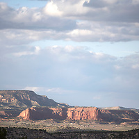 Sunlight hits the red rocks across from Fort Wingate Wednesday.