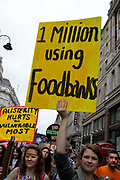 March against austerity, London June 20th 2015. One woman holds a placard saying 'One million using foodbanks' and another 'Austerity hurts the most vulnerable'.