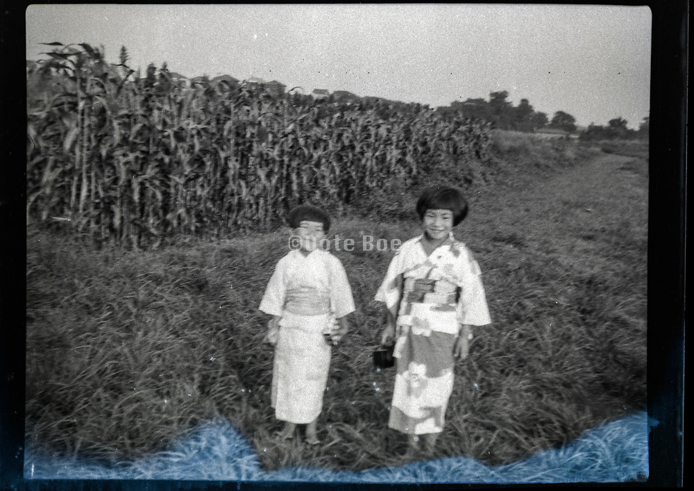 little children in kimono standing a corn field Japan ca 1940s