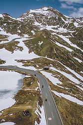 THEMENBILD - Motorradfahrer auf der Strasse mit der schneebedeckten Berglandschaft. Die Hochalpenstrasse verbindet die beiden Bundeslaender Salzburg und Kaernten und ist als Erlebnisstrasse vorrangig von touristischer Bedeutung, aufgenommen am 27. Mai 2020 in Fusch a.d. Glstr., Österreich // Motorcyclists on the road with the mountain landscape covered with Snow. The High Alpine Road connects the two provinces of Salzburg and Carinthia and is as an adventure road priority of tourist interest, Fusch a.d. Glstr., Austria on 2020/05/27. EXPA Pictures © 2020, PhotoCredit: EXPA/ JFK