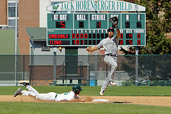 17 April 2016:  With a high off the bag throw, Matt Banaitis dives easily back into 2nd base during an NCAA division 3 College Conference of Illinois and Wisconsin (CCIW) Pay in Baseball game during the Conference Championship series between the North Central Cardinals and the Illinois Wesleyan Titans at Jack Horenberger Stadium, Bloomington IL