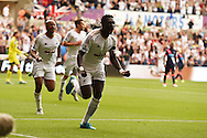 Bafetimbi Gomis of Swansea city celebrates after he scores his teams 1st goal. Barclays Premier League match, Swansea city v Newcastle Utd at the Liberty Stadium in Swansea, South Wales on Saturday 15th August  2015.<br /> pic by Andrew Orchard, Andrew Orchard sports photography.
