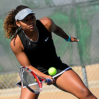 050814       Adron Gardner<br /> <br /> Number one ranked Grants Pirate Paris Corley plays Mesilla Valley Christian School SonBlazer Patty Borunda during a quarterfinal match of the state tennis championship at the Jerry Cline Tennis Complex in Albuquerque Thursday.