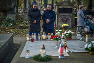 Two nuns remember their deceased loved ones at Rakowicki Cemetery in Krakow, Poland 2019.