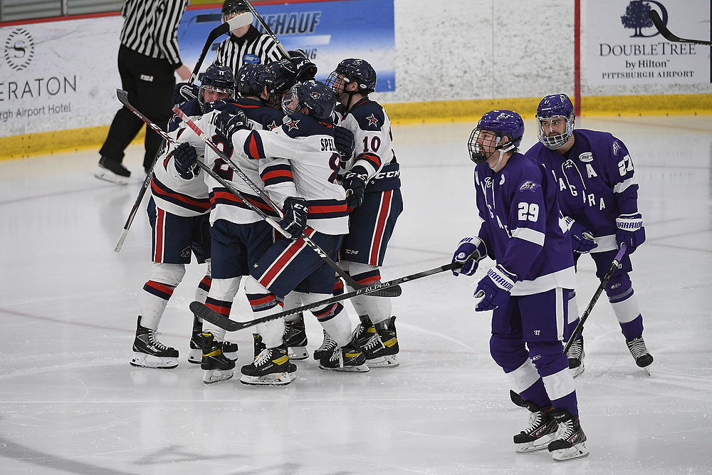 PITTSBURGH, PA - MARCH 12: Aidan Spellacy #8 of the Robert Morris Colonials celebrates with teammates after scoring a goal in the second period during Game One of the Atlantic Hockey Quarterfinal series against the Niagara Purple Eagles at Clearview Arena on March 12, 2021 in Pittsburgh, Pennsylvania. (Photo by Justin Berl/Robert Morris Athletics)