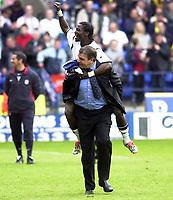 Photo:Greig Cowie<br />Barclaycard Premiership. Bolton Wanderers v Middlesbrough<br />11/05/2003<br />Jay Jay Okocha and Sam Allerdyce celebrate