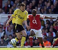 Photo: Daniel Hambury, Digitalsport<br /> Arsenal v Liverpool.<br /> FA Barclays Premiership.<br /> 08/05/2005.<br /> Arsenal's Lauren puts pressure on Liverpool's John Arne Riise<br /> Norway only